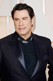 John Travolta  - 2018 Dark brown hair & comb over hair style.