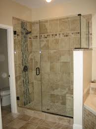 bathroom large transpa frameless glass shower areas having black handle on brown ceramics tiles wall