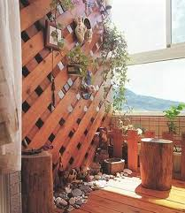 balcony design for home. an all natural wooden theme always looks amazing. add up with hanging plants as well balcony design for home
