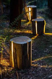 furniture made from tree trunks. beautiful cracked log lamps made from imperfect salvaged wood that can also be used as furniture tree trunks