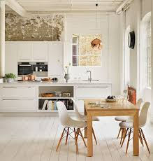 Scandinavian Kitchen with Exposed Brick Wall containing: White Kitchen  Island with Kitchen Cabinet also Wooden
