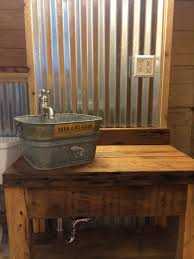 corrugated tin walls with cypress vanity and galvanized bucket great for barn bathroom
