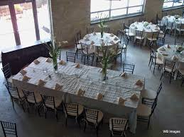 rectangular tables placed together to form a feasting table among round tables