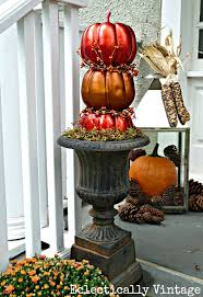 fall porch decorating tons of great diy ideas here like these topiary pumpkins kellyelko