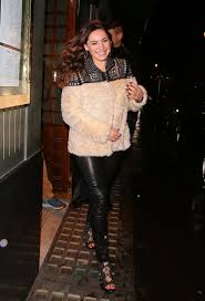 furry kelly brook wraps up warm in cream coat and tight leather leggings on night out