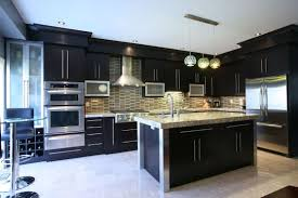Fancy Black Kitchen With Contemporary Design For Chic Cooking Space