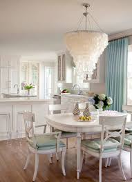 country chic lighting. Oval Dining Table With Shabby Chic Chairs And Capiz Chandelier Plus Blue Curtain Country Lighting