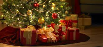 Our presents under our Christmas tree which should look like this. actually  look like this