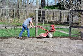 wilmer tilled the garden with our trusted troy bilt pony rear tine tiller it helps to level the ground as it turns over the soil