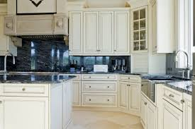 White Cupboards Over Beige Marble Flooring Surround Dark Blue Marble  Backsplash And Countertops In This Kitchen