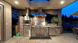 outdoor kitchen lighting. awesome outdoor kitchen design in terrace with stone backsplash along amazing lighting ceiling and ceramic tile floor