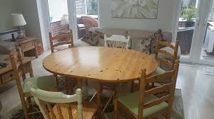 solid pine 5ft drop leaf gate leg dining table sits 6 in well used condition no chairs 57x42 inches