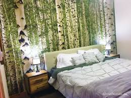 a birch tree forest wall mural behind a bed