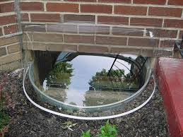 Brick basement window wells Drainage Basement Window Wells And Covers Backtobasiclivingcom Basement Window Wells And Covers Basement Window Well Covers For