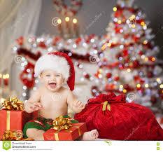 Christmas Photo Kids Christmas Baby In Santa Hat Kids Xmas Present Gift Stock