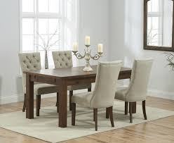 rustique 150cm dark solid oak extending dining table with anais fabric dark oak leg chairs