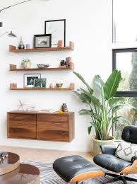 The room offers brown leather seats and a fireplace. How To Decorate A Large Blank Wall Hgtv