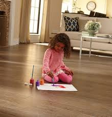 engineered hardwood resists moisture better and is more le than solid hardwood no wood flooring will tolerate standing water but increased moisture