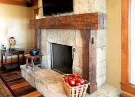 white stone stacked rustic fireplace with reclaimed lumber fireplace mantel for rustic home decor