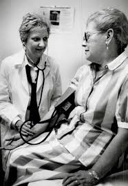 Helping hand: Sheila Griffith, manager of Amherst Pharmacies' home health  care division, takes Helena Steinitz's blood pressure. Seniors can drop  into the clinics while living at home. : Digital Archive : Toronto