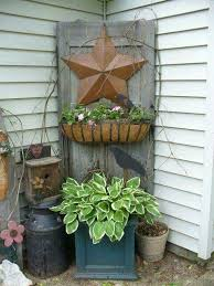 old door with hanging basket in the garden pay attention to the birdhouse i need to do this to mine