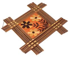 wall hanging in bamboo flower motifs shades of brown wall