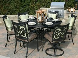black metal patio furniture sets with round table and light green cushions on outdoor dining set