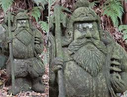 bishmon ten stone statue in private garden kura japan dated to taisho period