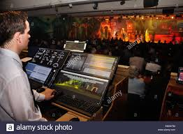 lighting technician. a lighting technician controls special effects for live stage performance stock image h