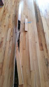 how to fix wood floors that are buckling