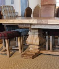 interior rustic solid oak extending dining table round and chairs extendable windermere rustic extendable dining table