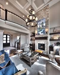 Great room: Open floor plan, floor to ceiling stone fireplace, overlook  from upper