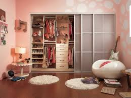 fascinating girls bedroom themes with sliding mirror closet doors and pink wall plus white bubble chair also white circular rug with wood bench and wood