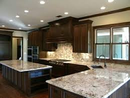 granite cabinets dark cabinets with alaska white granitethe only thing i would do diffe is white granite cabinets