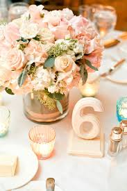 white painted wooden reception table numbers