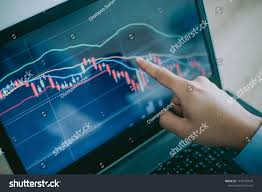 Hand Of Man Point To The Laptop Show Financial Market Chart