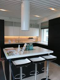 White concrete countertop with an island.
