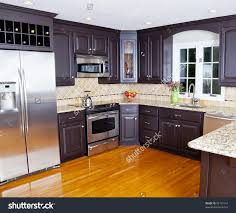 Kitchen Wooden Floor Modern Domestic Kitchen With New Appliances And Wooden Floor Stock