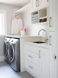 Example of a transitional gray floor dedicated laundry room design in  Toronto with an undermount sink