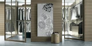 door wall art walk in closet design with glass door and brown wall paneling on grey door wall art