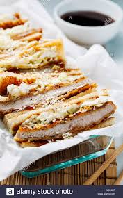 Katsu Sando - traditional japanese cutlet sandwich with deep fried  pork,cabbage,japanese mayonnaise and tonkatsu sauce on a light background  close-up Stock Photo - Alamy
