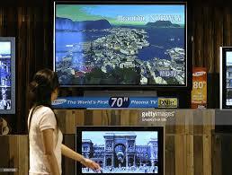 samsung tv 70 inch. a visitor walk pass the new samsung\u0027s 70-inch plasma tv features unprecedented visual quality samsung tv 70 inch