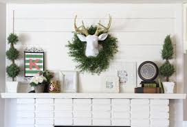 diy planked mantle and white brick fireplace