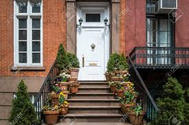 city apartment building entrance. entrance to greenwich village apartment with flowerpots on steps, new york city stock photo - building e