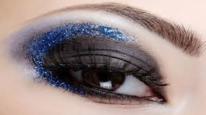 bright eye makeup of blue glitter look free
