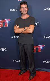 Simon Cowell Is 'Up and Walking' After Injury, Accident
