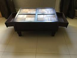 banana leaf coffee table with drawers over 200 when new