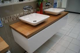 modern white wall mounted vanity with walnut top and 2 white vessel sinks for bathroom furniture