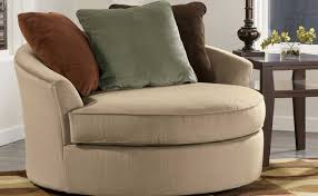 Swivel Chairs For Living Room Large Swivel Chairs Living Room In Beige Color With Brown Pillows