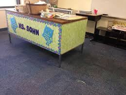 adorable way to brighten up an old metal desk contact paper from